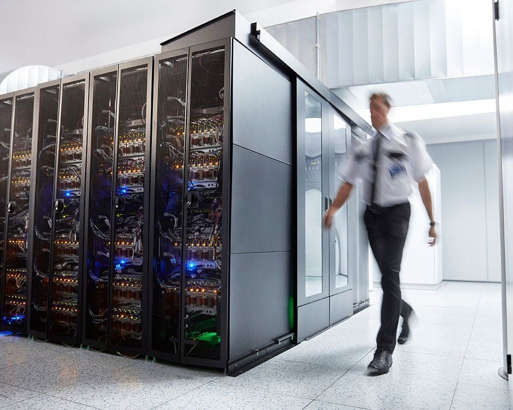 Cyber security: A security guard checks the server room
